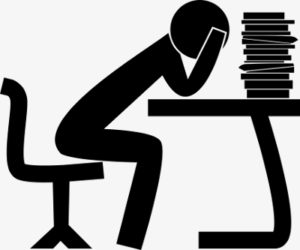 Illustration of person at desk, holding head in hands, facing a big pile of papers